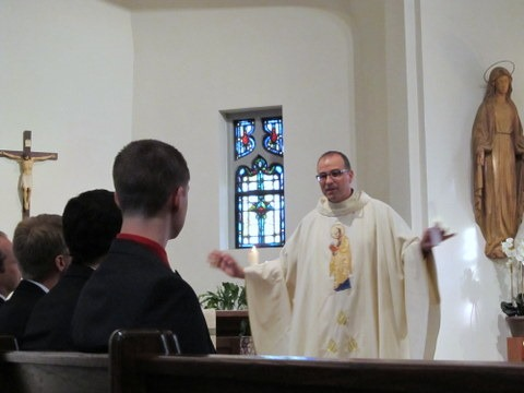 Fr. Eric Andrews delivers encouraging words to the novices during his homily at the First Promises Mass.