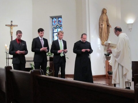 This year's novices promising to obey the Paulist Constitution and professing their belief that they are called to be missionaries.