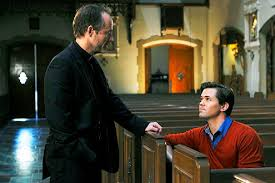priest talking to man