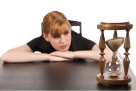 woman-watching-hourglass