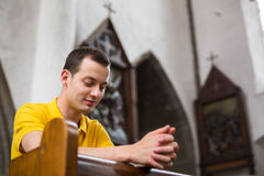 young-man-praying-church-handsome-41152818