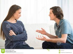man-explaining-woman-arguing-living-room-young-men-women-40422131
