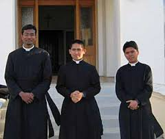 Image result for priest wearing cassock