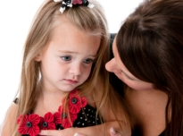 1381656446_Grieving-girl-with-mother
