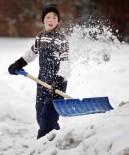 boy shoveling snow