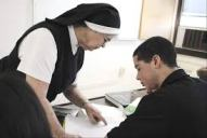 nun teaching boy