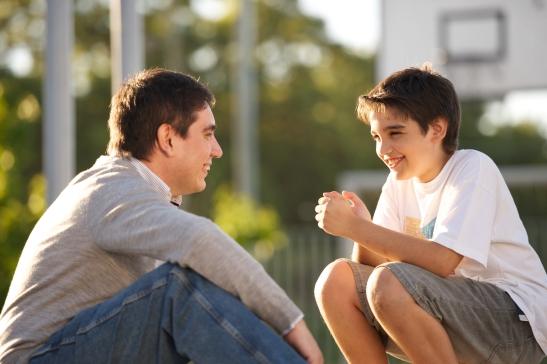 Father Son Talking 1081076 Wallpaper